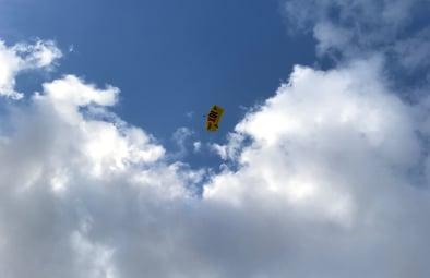 grant-parachuting-blue-sky