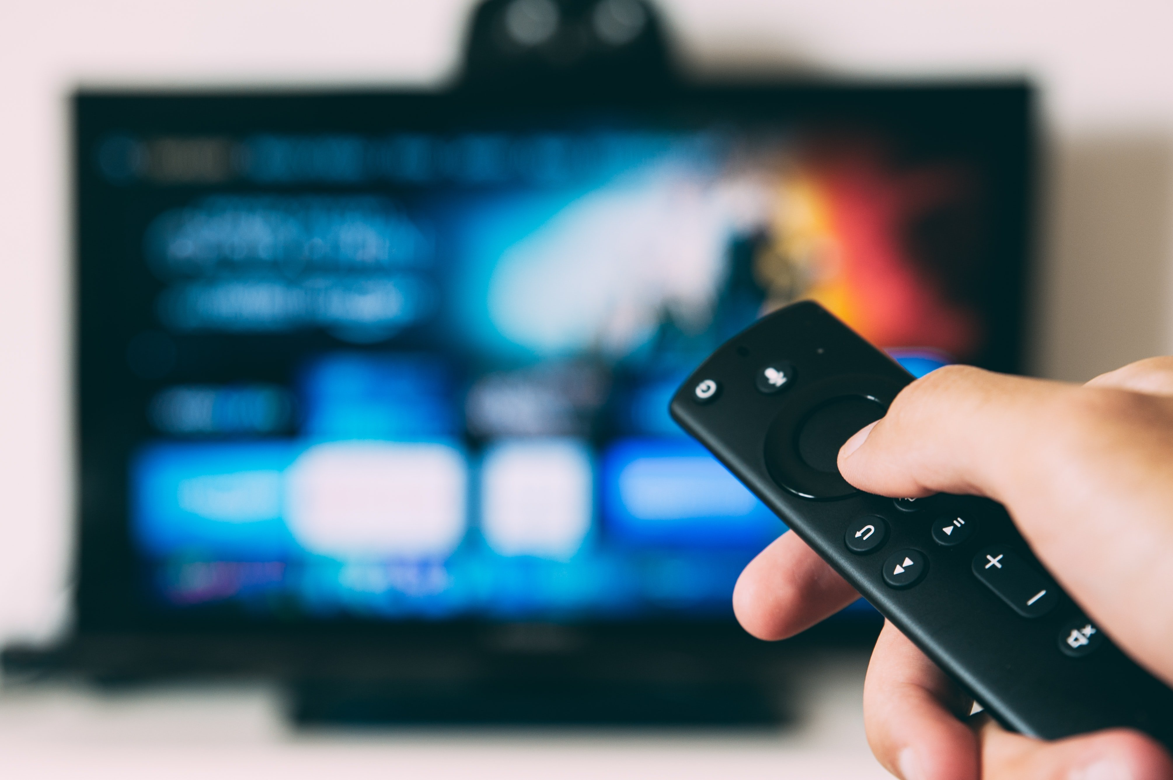 Watching-OTT-Streaming-TV-hand-with-remote