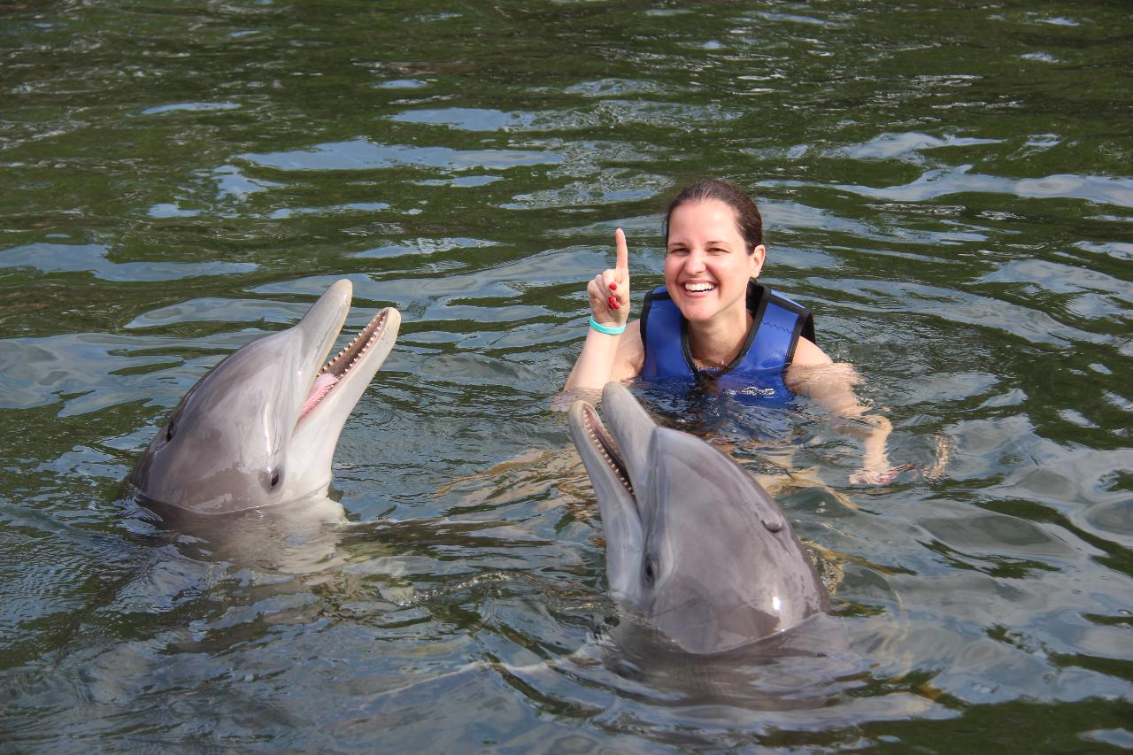 dolphins-plus-girl-pointing-up-with-two-dolphins