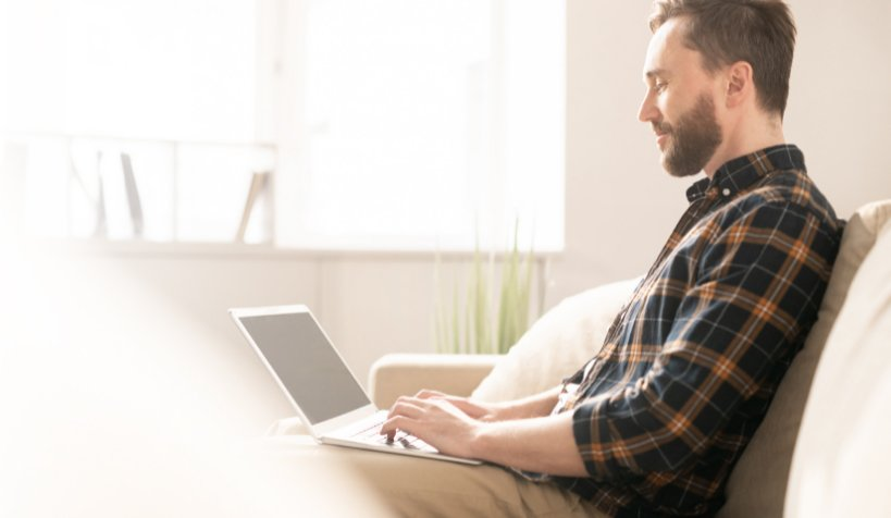 man working from home on laptop focused on results